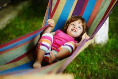 Cute girl resting lying on hammock Stock Photo