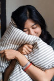 Cute girl resting on soft pillow Royalty Free Stock Photography