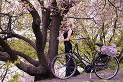 Cute girl and retro bike Stock Photos