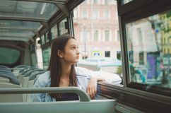 Girl rides in the tour bus and looks out the window. Saint Petersburg, Russia. Cute girl rides in the tour bus and looks out the window. Saint Petersburg royalty free stock image