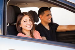 Cute girl riding with her partner Stock Photo