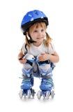 Cute girl in roller skates Stock Photo