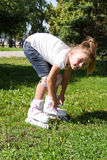 Cute girl on roller skates in summer Royalty Free Stock Photos