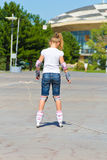 Cute girl on roller skates in summer Royalty Free Stock Image