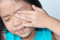 Cute girl rub her eyes Stock Photos