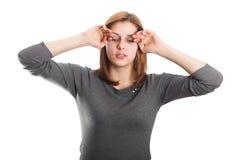 Cute girl rubs her hands eyes Stock Photos