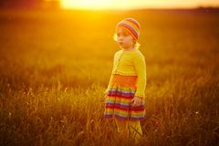 Cute girl runnig to the sunset Royalty Free Stock Photos