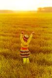 Cute girl runnig to the sunset Stock Photo