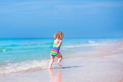 Cute girl running on a beach Royalty Free Stock Photo