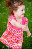 Cute girl running and smiling at camera Royalty Free Stock Image
