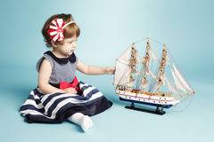 Cute girl sailor with model ship Stock Image