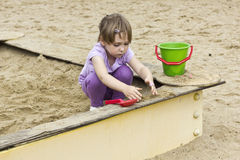 Cute girl at sandbox Stock Photography