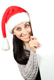 Cute girl in a Santa Claus hat. isolated Royalty Free Stock Photography