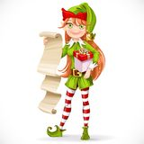 Cute girl Santa elf with list on parchment Stock Photo