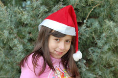 Cute girl with Santa hat Royalty Free Stock Photography