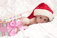 Cute girl with Santa hat Stock Photos