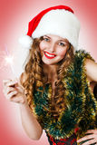 Cute girl in Santa hat holding sparklers Royalty Free Stock Photography