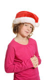 Cute girl with santa hat Stock Image