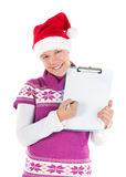 Cute girl with Santa hat showing a blank paper Stock Photography