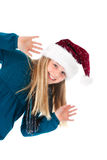 Cute girl with santa hat on white waving Royalty Free Stock Image