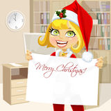 Cute girl in Santa suit hold blank Christmas banne Stock Photo