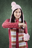 Cute girl save money in piggy bank Royalty Free Stock Photography