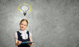Cute girl of school age Stock Images