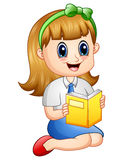 Cute girl in a school uniform reading a book Royalty Free Stock Image