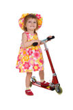 Cute girl and scooter Royalty Free Stock Photo