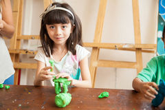 Cute girl sculpting with clay Stock Photos