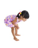 Cute girl sees something on the floor Royalty Free Stock Images