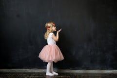 Cute Girl Sends an air kiss. Cute little Girl Sends an air kiss Stock Image