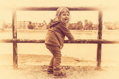Cute girl in sepia. Retro stylized grainy sepia photo of a cute girl on a bank of river Thames stock images