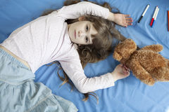 Cute girl seven years old lying on bed. Little cute girl seven years old lying on bed royalty free stock photography