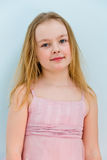 Cute girl seven years old. Portrait of cute girl with blond hair royalty free stock photo