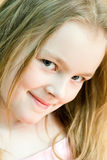 Cute girl seven years old. Portrait of cute girl with blond hair royalty free stock images