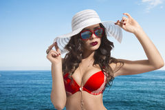 Cute girl in sexy bikini on seaside Royalty Free Stock Image