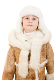 Cute girl in a sheepskin coat and hat looking up Royalty Free Stock Photos