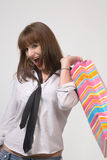 Cute girl with shopping bags. Over grey background Stock Photography