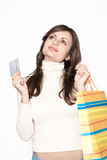 Cute girl with shopping bags and credit card Royalty Free Stock Photography