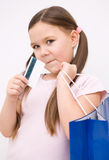 Cute girl with shopping bags. Cute little girl with colorful shopping bags Stock Images