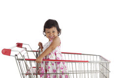 Cute girl on shopping cart Stock Photos