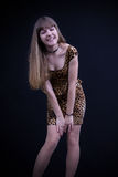 Cute girl in a short dress Stock Photos
