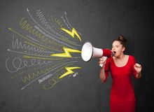 Cute girl shouting into megaphone with hand drawn lines and arro Stock Photo