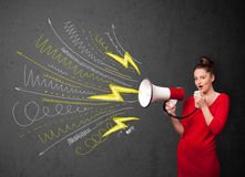 Cute girl shouting into megaphone with hand drawn lines and arro Royalty Free Stock Image