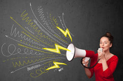 Cute girl shouting into megaphone with hand drawn lines and arro Royalty Free Stock Images