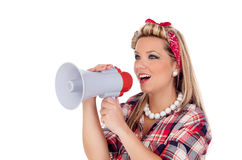 Cute girl shouting by megaphone in pinup style Royalty Free Stock Photos