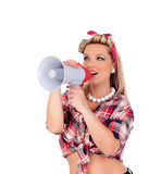 Cute girl shouting by megaphone in pinup style Stock Images