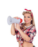 Cute girl shouting by megaphone in pinup style Stock Image