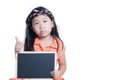 Cute girl show black board isolated Stock Photos
